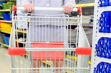 empty shopping cart - Woman shopping in a supermarket Stock Photo - Rights-Managed, Code: 837-03071985