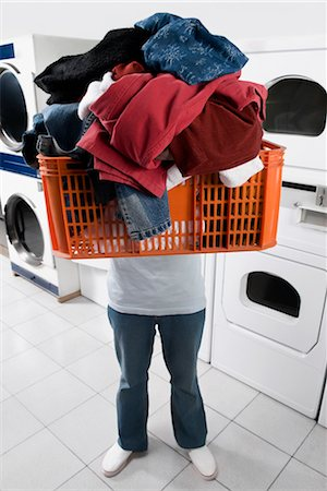 Man carrying a basket in a laundromat Stock Photo - Rights-Managed, Code: 837-03072025