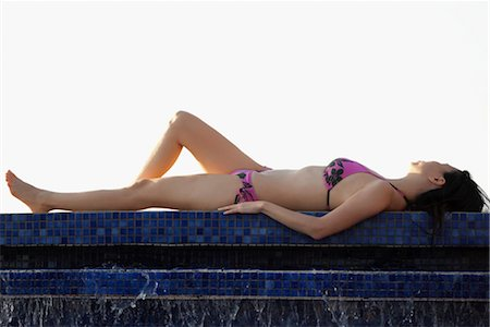Woman sunbathing at the poolside Stock Photo - Rights-Managed, Code: 837-03072284