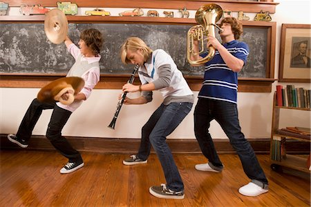 Three teenage boys playing musical instruments in a classroom Stock Photo - Rights-Managed, Code: 837-03072415