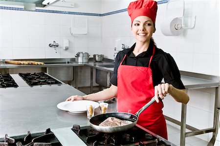Female chef cooking food in the kitchen Stock Photo - Rights-Managed, Code: 837-03072448