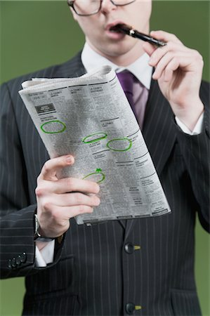 Close-up of a businessman marking on a newspaper Stock Photo - Rights-Managed, Code: 837-03072449