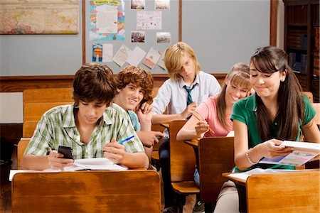 Students sitting in a classroom Stock Photo - Rights-Managed, Code: 837-03072481
