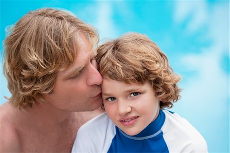 preteen kissing - Man kissing his son at the poolside Stock Photo - Rights-Managed, Code: 837-03072833