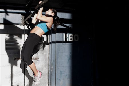 fitness   mature woman - Side profile of a woman doing chin-ups Stock Photo - Rights-Managed, Code: 837-03073031