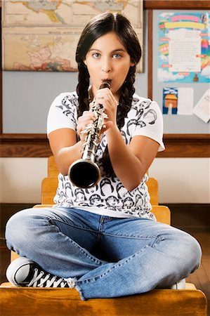 Schoolgirl playing a clarinet in a classroom Stock Photo - Rights-Managed, Code: 837-03073062