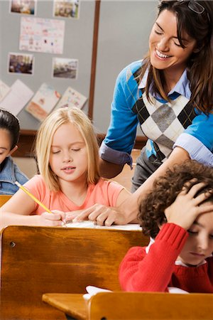Students with their teacher in a classroom Stock Photo - Rights-Managed, Code: 837-03073167
