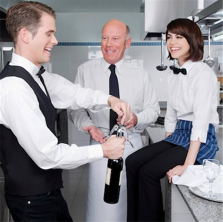 Waiter opening a wine bottle Stock Photo - Rights-Managed, Code: 837-03073242