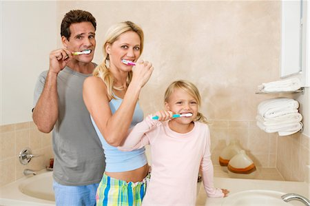 Family brushing teeth in the bathroom Stock Photo - Rights-Managed, Code: 837-03073415