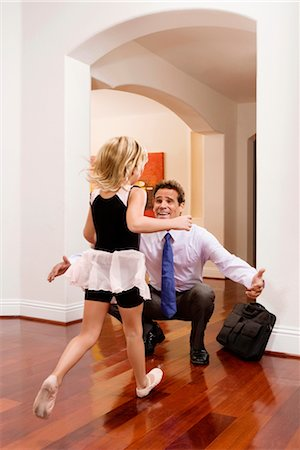 Businessman receiving a warm welcome from his daughter Stock Photo - Rights-Managed, Code: 837-03073574