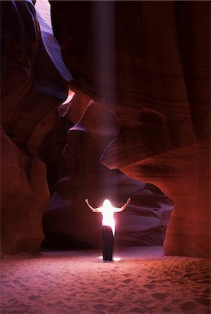 page - Sunbeam falling on a woman in a canyon,Antelope Canyon,Page,Arizona,USA Stock Photo - Rights-Managed, Code: 837-03073584
