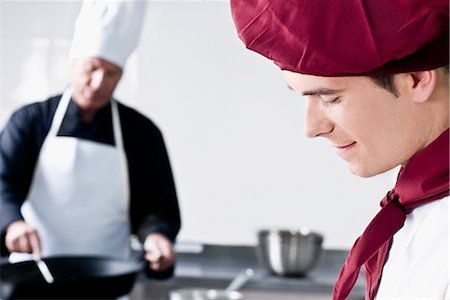 Two chefs cooking food in the kitchen Stock Photo - Rights-Managed, Code: 837-03073582