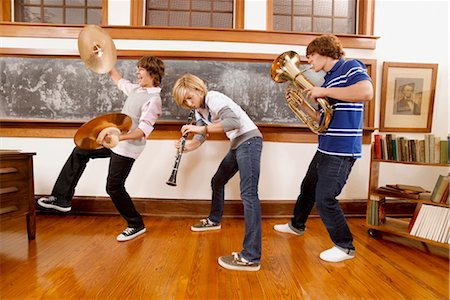 Three students playing musical instruments in a classroom Stock Photo - Rights-Managed, Code: 837-03073620