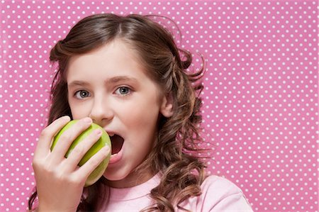 preteens fingering - Close-up of a girl eating an apple Stock Photo - Rights-Managed, Code: 837-03184058