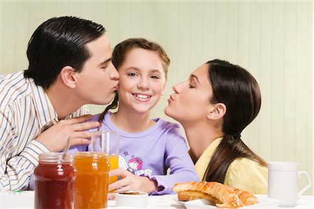 preteen kissing - Couple kissing their daughter Stock Photo - Rights-Managed, Code: 837-03184111