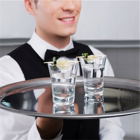Waiter holding a tray of tequila shots Stock Photo - Rights-Managed, Code: 837-03184272