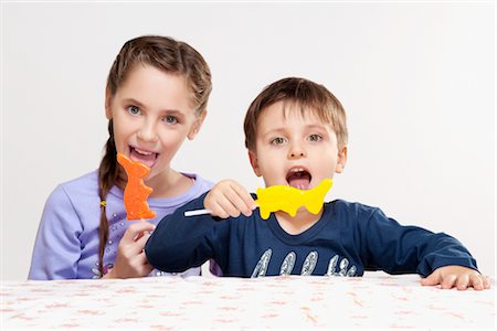 preteen girl licking - Boy and his sister eating candies Stock Photo - Rights-Managed, Code: 837-03184581