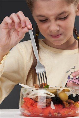 sad girls - Close-up of a girl frowning at a bowl of salad Stock Photo - Rights-Managed, Code: 837-03184619