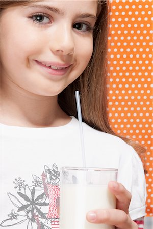 preteen  smile  one  alone - Girl holding a glass of milk Stock Photo - Rights-Managed, Code: 837-03184902