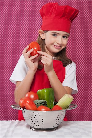 preteen  smile  one  alone - Portrait of a girl holding a tomato Stock Photo - Rights-Managed, Code: 837-03185073