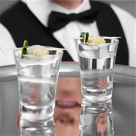 Waiter holding a tray of tequila shots Stock Photo - Rights-Managed, Code: 837-03185492