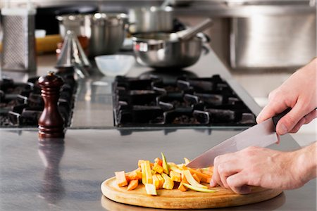 Chef chopping vegetables with a knife Stock Photo - Rights-Managed, Code: 837-03185851