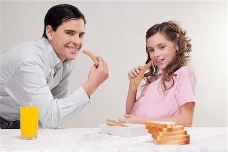 preteens fingering - Man with his daughter at a breakfast table Stock Photo - Rights-Managed, Code: 837-03185933