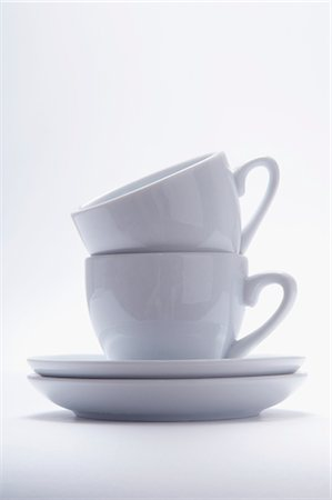 Close-up of a pile of two cups and saucers Stock Photo - Rights-Managed, Code: 837-03186913
