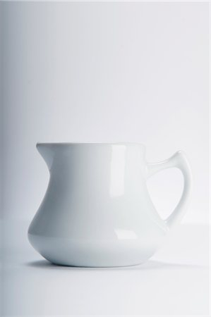 Close-up of a white ceramic jug Stock Photo - Rights-Managed, Code: 837-03187544