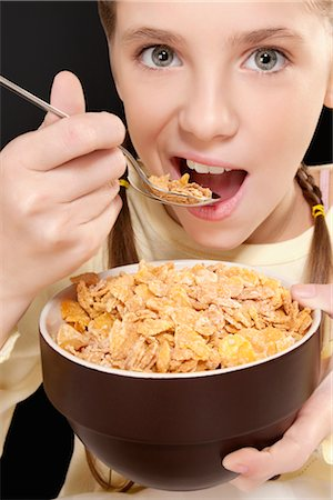 preteens fingering - Portrait of a girl eating corn flakes Stock Photo - Rights-Managed, Code: 837-03187982