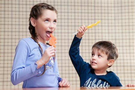 preteen girl licking - Boy and his sister holding candies Stock Photo - Rights-Managed, Code: 837-03183253