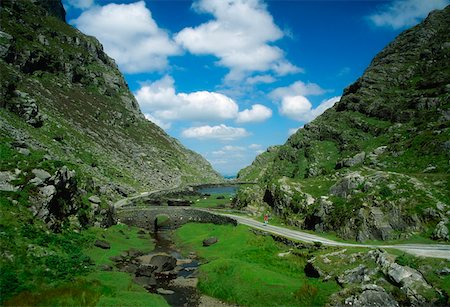road landscape - Gap of Dunloe, Killarney National Park, County Kerry, Ireland; Cyclists in the distance Stock Photo - Rights-Managed, Code: 832-02255419