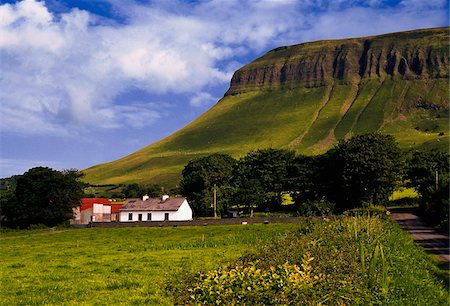 Ben Bulben, Co Sligo, Ireland, Cottage below a large rock formation Stock Photo - Rights-Managed, Code: 832-03233364
