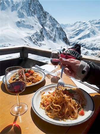 Skiers eating spaghetti alfresco on the sun terrace at Refuge Bella Vista Stock Photo - Rights-Managed, Code: 832-03724542