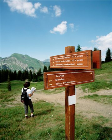 Hiker in alps reading map Stock Photo - Rights-Managed, Code: 832-03724747