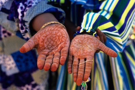 Henna patterns on hands Stock Photo - Rights-Managed, Code: 832-03724977