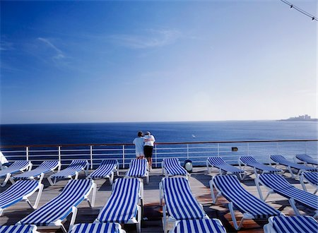 Mature couple hugging on the desks of cruise ship off Bahamas Stock Photo - Rights-Managed, Code: 832-03723637