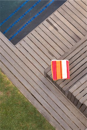 residential - Elevated view of folded towel on decking. Stock Photo - Rights-Managed, Code: 845-05837788