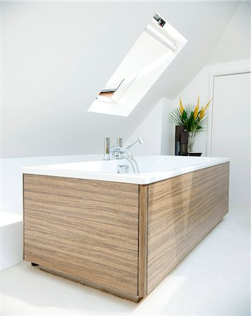 Freestanding wood panelled bath in attic conversion, Southampton, UK. Stock Photo - Rights-Managed, Code: 845-05838115