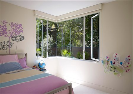 Bedroom with corner windows . walls decorated with butterlies and painted flowers. Architects: Dumican Mosey Architects Stock Photo - Rights-Managed, Code: 845-05838195
