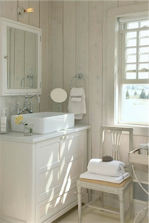 Storage Country Style Square Washbasin Set On Cupboard Unit In Modern Country Style Bathroom Stock