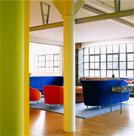red chair - Blue and red seating in modern open plan room, Harper Mackay Architects Stock Photo - Rights-Managed, Code: 845-05838851