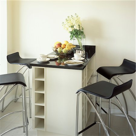 Kitchen breakfast bar with stools. Stock Photo - Rights-Managed, Code: 845-05838871