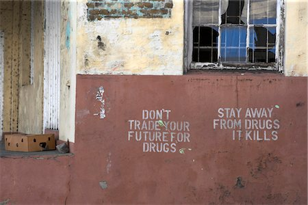 stencils - Broken window and warning against the use of drugs, Grenada, West Indies. Stock Photo - Rights-Managed, Code: 845-06008081