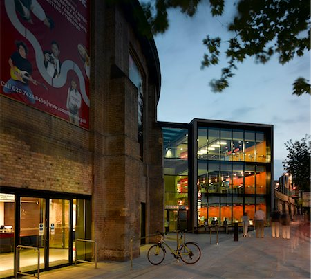 The Roundhouse Theatre, Camden, London. New extension exterior at dusk. Architects: John McAslan and Partners Stock Photo - Rights-Managed, Code: 845-03720395