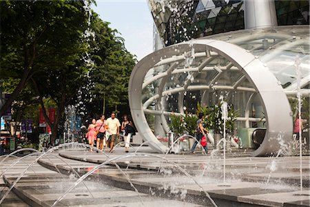 Street level entrance to MRT and ION Orchard shopping mall by Benoy and RSP Architects Planners & Engineers. Located on Orchard Road in Singapore, it opened in July 2009. Architects: Benoy and RSP Architects Planners and Engineers Stock Photo - Rights-Managed, Code: 845-03721317