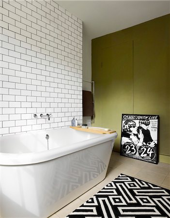 Modern bathroom in Georgian house in Islington, Loondon with white tiled wall and black and white geometric patterned. Architects: Dominic McKenzie Stock Photo - Rights-Managed, Code: 845-03721383