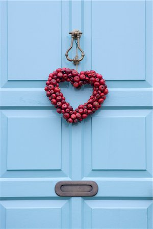 Christmas wreath on a sky blue door, England. Stock Photo - Rights-Managed, Code: 845-03777294