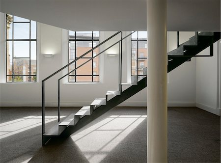 Staircase in an open plan office space in a refurbished chapel. Architects: OMI Architects Stock Photo - Rights-Managed, Code: 845-03777615