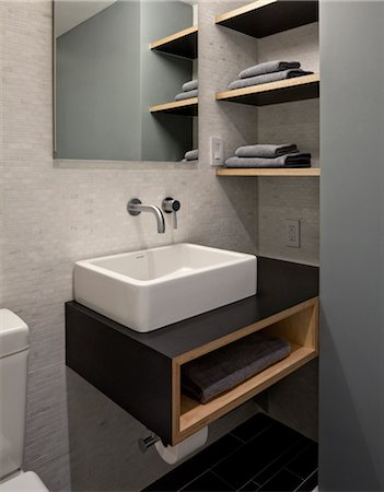rectangle - bathroom with toilet, modern rectangular washbasin and storage shelves. Architects: WE Design - Winston Ely Stock Photo - Rights-Managed, Code: 845-03777623